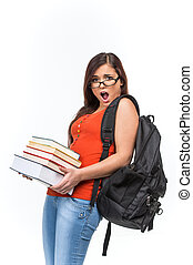 Attractive young female college student. young woman carrying stack of books