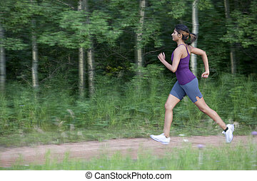 Attractive Young Female Power Walking - An attractive young...