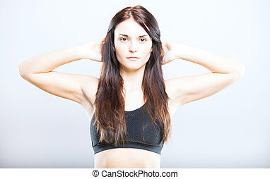 Attractive young fit woman, exercising