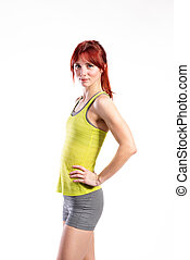 Attractive young fitness woman in green tank top. Studio shot.
