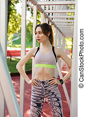 Attractive young fitness woman wearing sports clothing ...