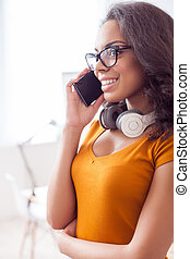 Attractive young girl is calling to someone