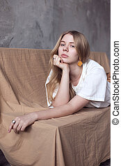 Attractive young girl lying on a bench