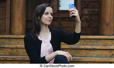 Attractive young girl posing to take a selfie on mobile