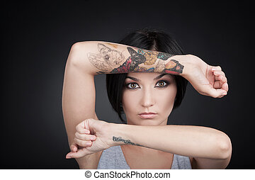 attractive young girl showing tattoo hands. beautiful woman...