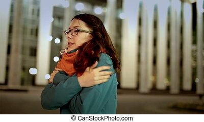 Attractive young girl wait for her boyfriend love. They happy meet and embrace.
