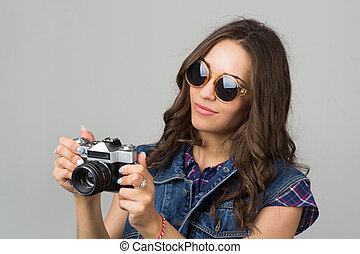 attractive young girl with a camera