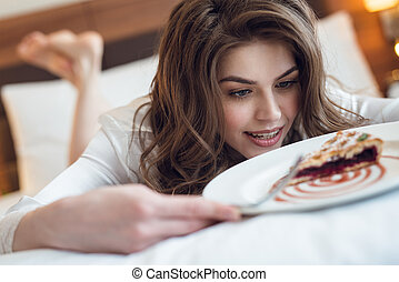 Attractive young girl with a pie