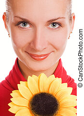 Attractive young girl with a sunflower