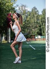 Attractive young girl with a tennis racket