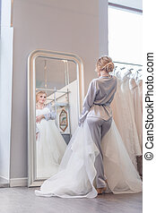 Attractive young girl with a wedding dress