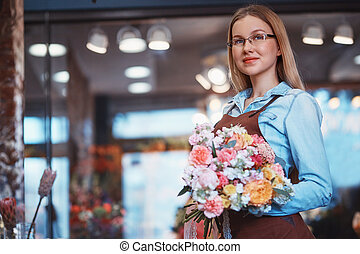 Attractive young girl with bouquet
