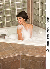 Attractive young gorges woman taking Bubble bath