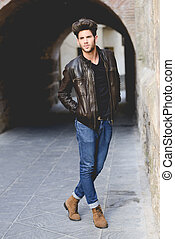 Attractive young handsome man in urban background