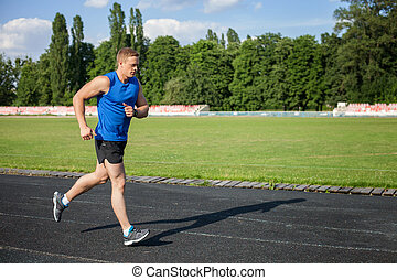 Attractive young healthy male runner is training