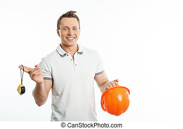 Attractive young healthy man with working equipment