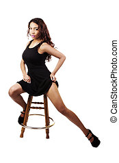 Attractive Young Hispanic Woman Sitting In Black Dress