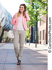 Attractive young lady walking in the city