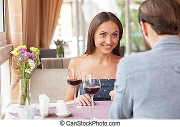 Attractive young loving couple is dating in cafe