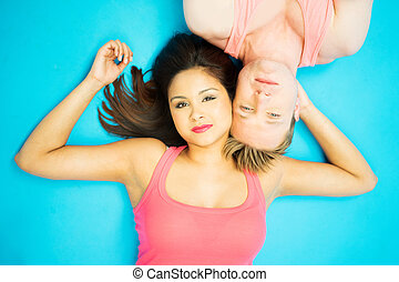 Attractive young man and woman lying head to head