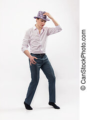 Attractive young man dancing in a hat