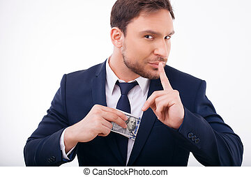 Attractive young man is keeping away his savings - Handsome...