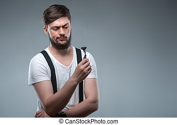 Attractive young man is preparing for shaving