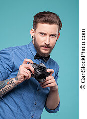 Attractive young man is ready to photograph