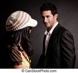 Attractive young man looking at trendy woman
