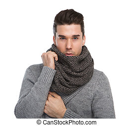 Attractive young man posing with gray wool scarf