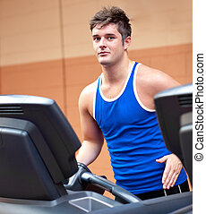 Attractive young man running on a r