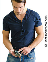 Attractive young man standing with compass in his hand