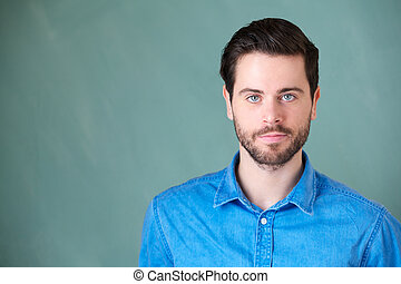 Attractive young man with beard looking at camera