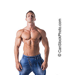 Attractive young man with naked muscular torso, wearing jeans