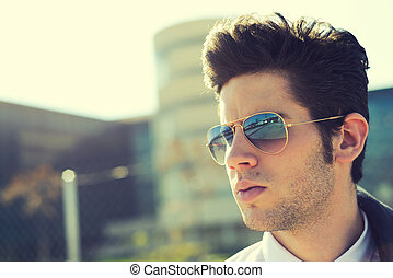 Attractive young man with sunglasses - Portrait of a...