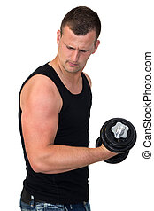 Attractive Young man working out with weights