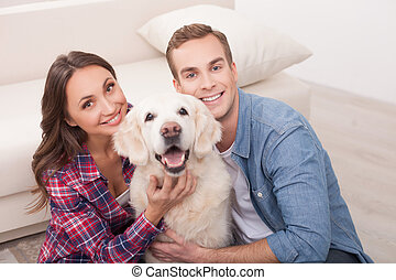 Attractive young married couple with cute pet