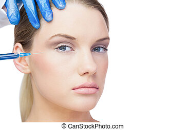 Attractive young model having botox injection