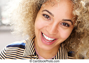 Attractive young modern african american woman smiling
