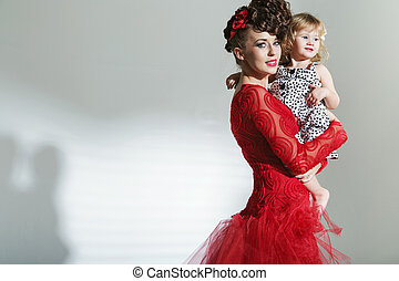 Attractive young mother with little daughter