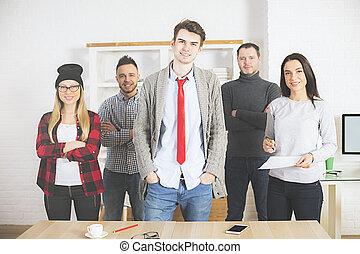 Attractive young people in office