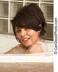 Attractive young sexy female taking bath