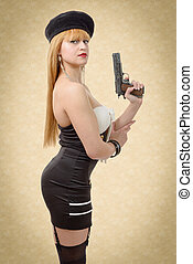 attractive young sexy woman with a gun