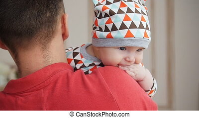 Attractive young single dad spending some time with his baby at home