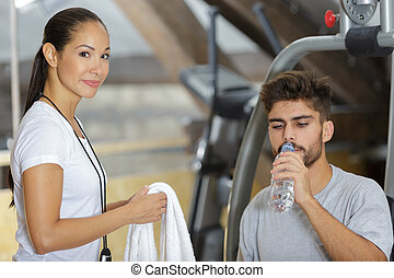 attractive young sports people in the gym