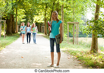 Attractive young teenage girl on her way to class