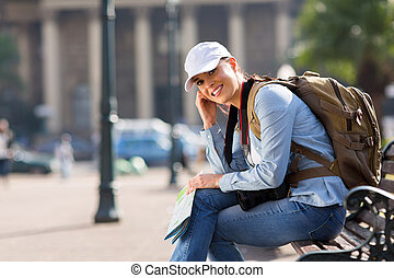 young tourist sitting outdoors