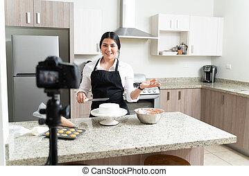 Attractive Young Vlogger Preparing Dessert In Kitchen