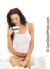 Attractive young with mug of something hot.