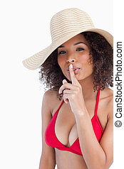 Attractive young woman asking for silence